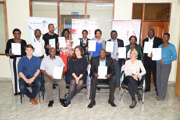 STEP Trainers from MKU and KNATCOM display their certificates. With them is the team of trainers from Leuphana University Germany.